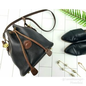 Dooney & Bourke all leather weather drawstring bag